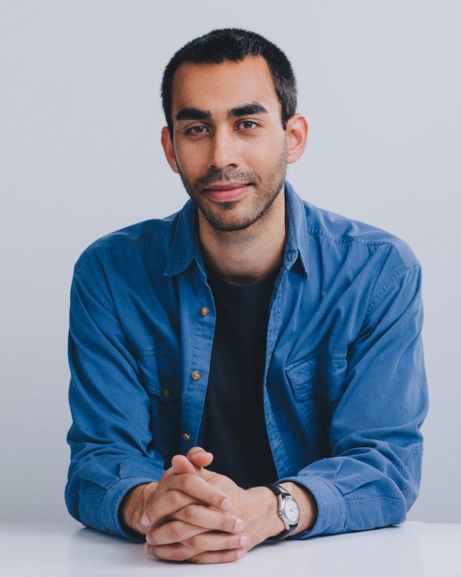 young man wearing jean shirt