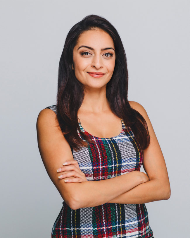 female business professional in plaid dress