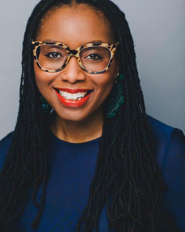 african american woman with red lipstick and funky glasses