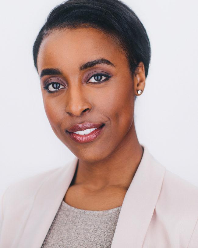black female professional with short slick hair