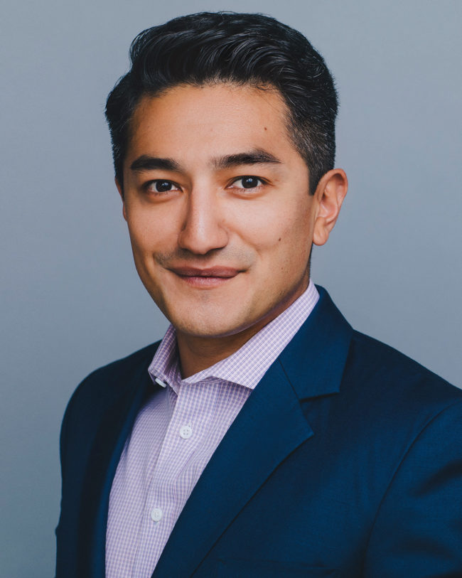 smiling real estate agent in casual suit