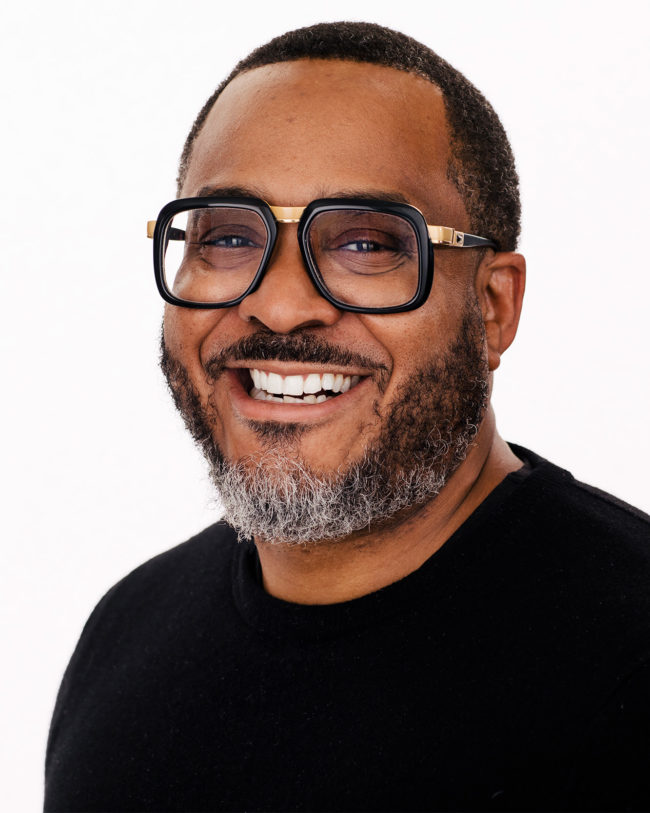 smiling black business man with stylish glasses