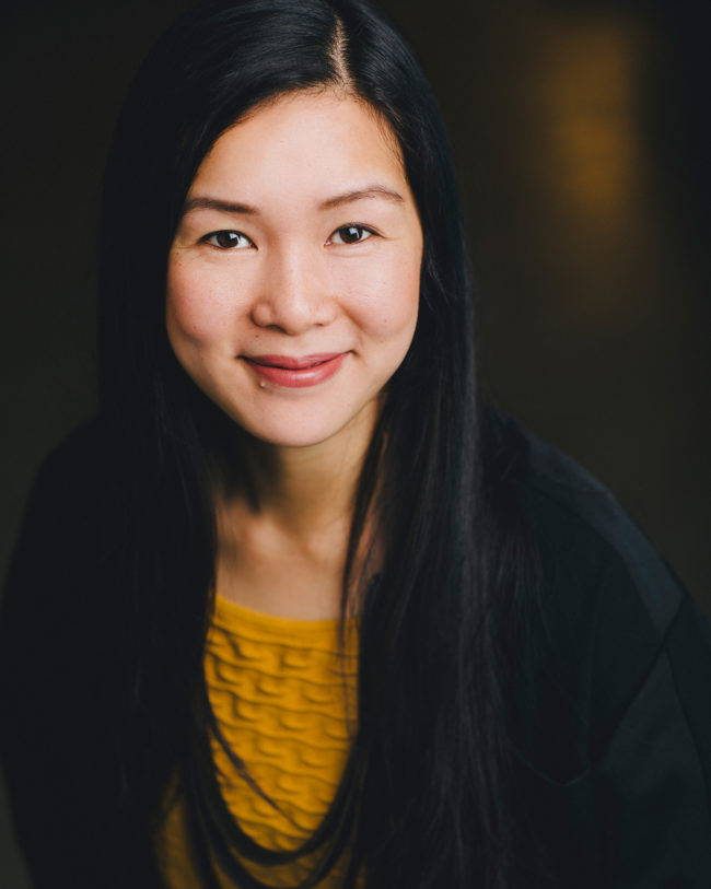 smiling asian woman in yellow top