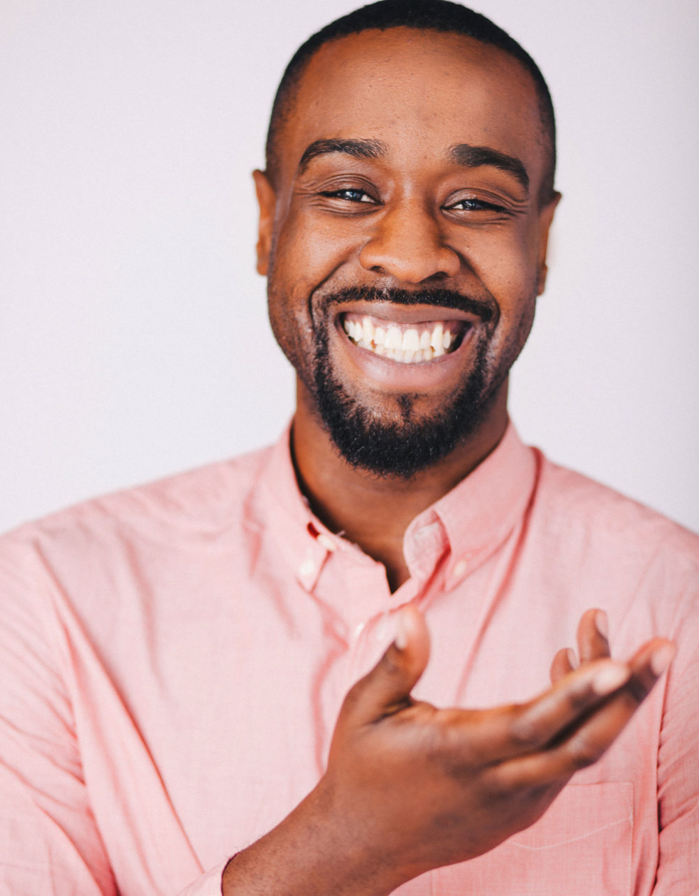 laughing black actor with huge smile