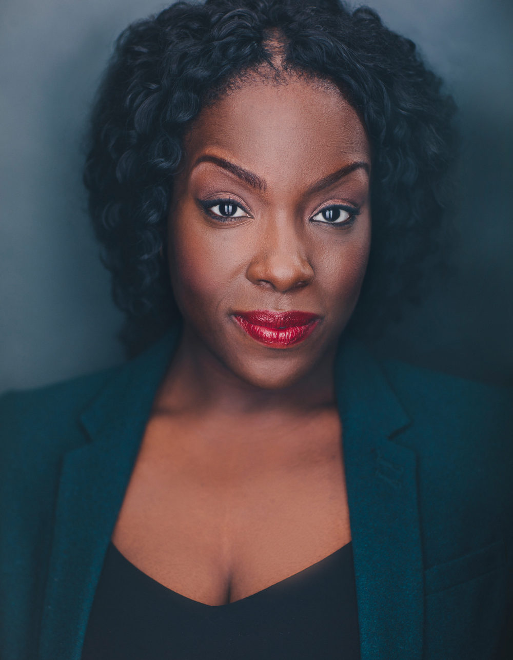 black actress with bright red lipstick