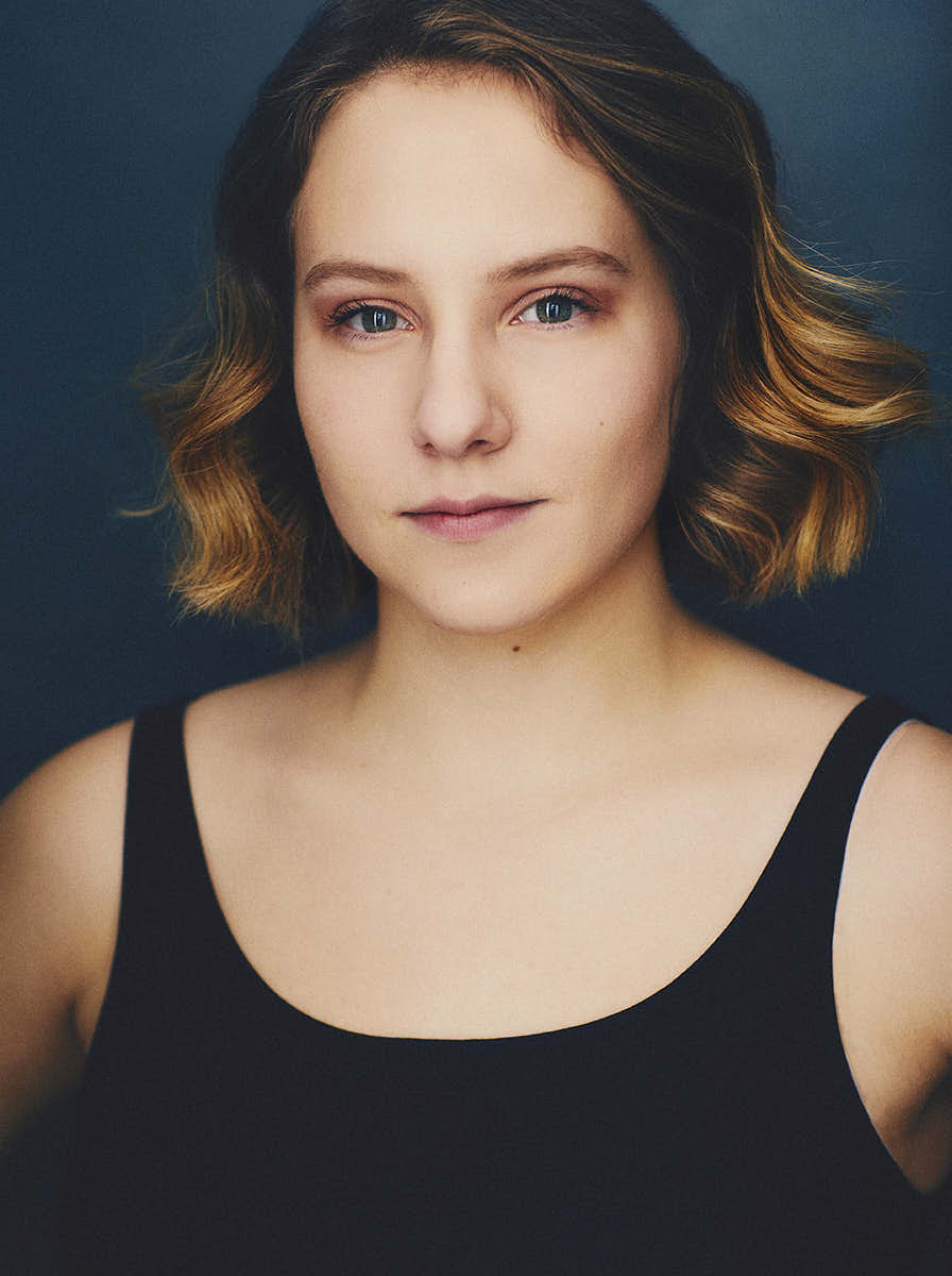 actress with short hair looking serious