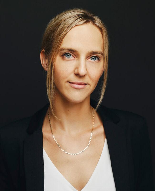 blonde woman in black blazer
